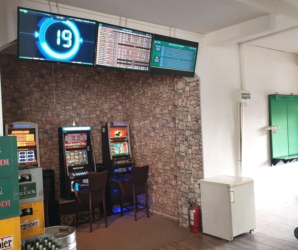 Percheziții în București și Timiș la hoți din agenții de pariuri